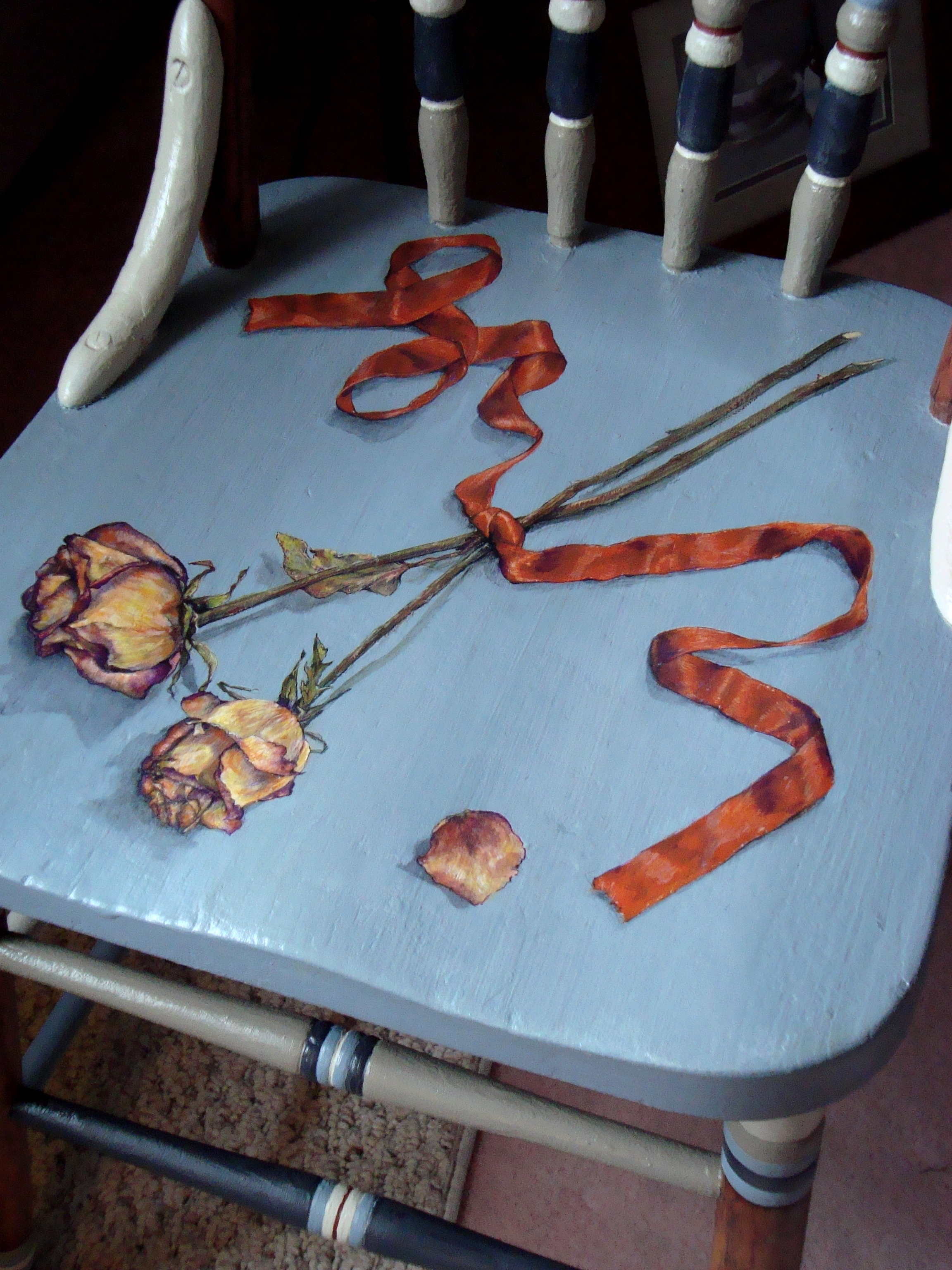 Chair Painted With Ribbons and Dried Roses