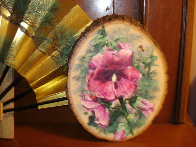 Hollyhock on Wood Slice