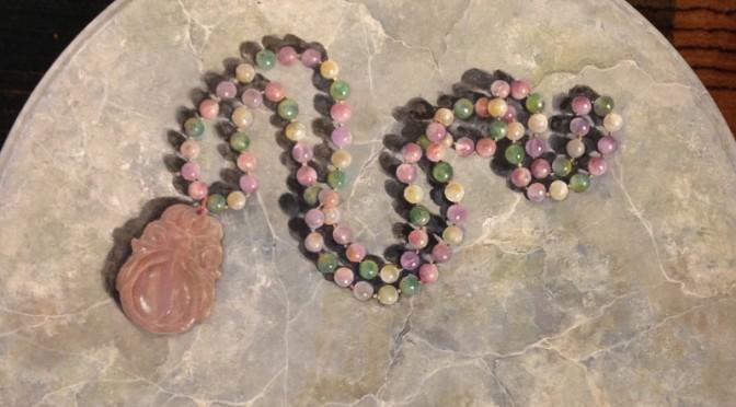Quartz Beads on Faux Grey Marble Pedestal Table